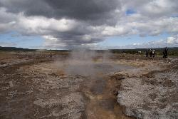 Photo of the Strokkur geyser after it has erupted.  It is located at the same site as the Great Geysir.