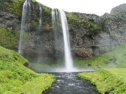 Photo of the Seljalandsfoss waterfall in Iceland.  Taken during June 2010.  Long shutter makes water appear solid.