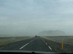 A photo of ashes giving a foggy appearance on the road near Eyjafjallajökull in Iceland.  Taken
