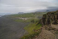 Photo of a black sand beach near Dyrhólaey in Iceland. Just around the corner is Vik. Photo taken from Dyrhólaey.
