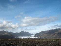 Photo of Skaftafellsjökull glacier from a distance. Kristinartindar is on the left, Hafrafell on the right.