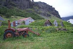 Photo of the barns and tractor on the Nupsstadur historical site in Iceland.