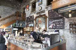 Inside Balzacs Coffee.  Shows front counter and menu items.  Located in the Distillery District in Toronto Ontario.
