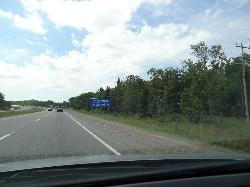 Population sign for Bracebridge Ontario, along Highway 11 South.