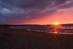 Photo taken during summer sunset at Ipperwash Beach in Ipperwash Provincial Park, positioned near Kettle Point.