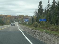 Travelling west along Highway 118 is the city limits sign for the community of Cardiff Ontario.