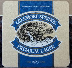 A beer coaster from Creemore Springs Brewery Limited. This 2017 version featuring their Premium Lager, has a drawing of a spring in it.  It also states that Creemore Springs was established in 1987.