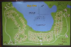 A map of Cyprus Lake Campground, showing all the camp sites on the grounds.  Located in Bruce Peninsula National Park.  Located on a sign post near the entrance.