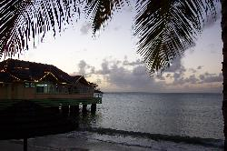 Shoadow view of the Pier restaurant at Sandals Halcyon Beach Resort in St. Lucia.