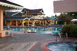 Photo of main pool and buffet restaurant, at Sandals Halcyon Beach Resort in Castries St. Lucia.