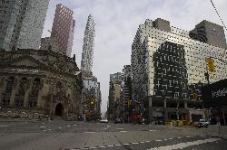 Photo looking north on Yonge Street in Toronto at the intersection of Front Street.  Viewable are the Hockey Hall of Fame, Scotia Tower and the One King Street Tower.