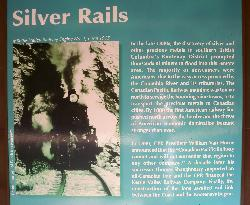 Sign in Coquihalla section of Kettle Valley Railway.  Describes how this train was built to transport American miners going north to find precious metals.