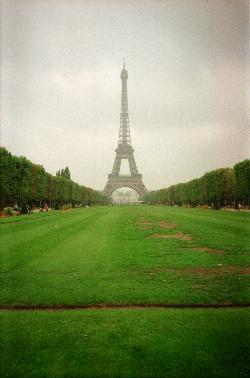 View of the Eiffel Tower from the Ecole Militaire side of tower, closed to Pl Jacques Rueff.  Scanned from a negtive.