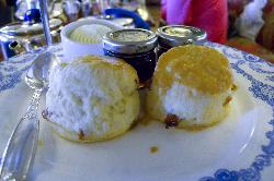 The middle plate at the Afternoon Tea was tea biscuits with jams and butter.  At the Fairmont Empress Hotel in Victoria British Columbia.