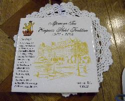 A coaster describing the origins of the afternoon tea at the Fairmont Empress Hotel in Victoria British Columbia.