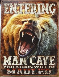 Photo of sign in store.  Entering Man Cave, Violators will be Mauled.