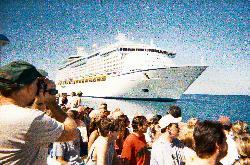 Shuttle boat leaving the Explorer of the Seas anchored off the shore of Labadee Haiti.  Photo taken with an underwater film camera.