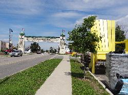 Archway over Muskoka Rd, welcoming travellers to Gravenhurst Ontario.  Sigh also say it is the Gateway to Muskoka Lakes.
