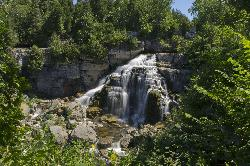 Inglis Falls is located near Owen Sound Ontario.  This photo show a longer shutter speed and smaller aperture to get a smooth waterfall effect.