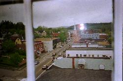 A view of Main Street in Littleton New Hampshire.  Take from an upper level room at Thayers Inn.  Scanned from a negative.