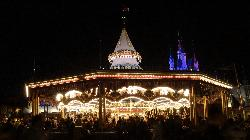 Photo of the Prince Charming Regal Carrousel at Magic Kingdom in Disney World Orlando Florida.  Taken in the evening, it shows off all of the lights inside the carrousel.