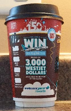 This is the side of the 2017 version of the medium Monopoly coffee cup from McDonalds.  It also has Canada's 150th anniversary printed at the top.  This side is in English, the opposite side is in French.