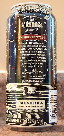 The front view of a Shinnicked Stout beer can.  Brewed by Muskoka Brewery. Inscription on back of can: Shinnicked is that numbing, gasp-for-breath feeling you get when plunging into a Muskoka lake for a chilly late-night dip. To warm you up afterward we created this rich, velvety stout infused with Muskoka Roastery's Signature Lumberjack coffee.