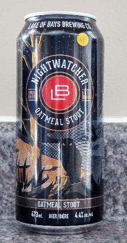 The front view of beer can for Nightwatcher Oatmeal Stout beer, brewed by Great Lakes Brewery.  The art on the beer can depicts an owl in the wilderness.  Great Lakes Brewery is located in Toronto Ontario.