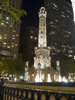 Chicago Water Tower lit up at night.