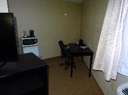 Room 125 at the Quality Inn in Bracebridge. A view the nook area with desk and fridge, which is located in the side of the room.
