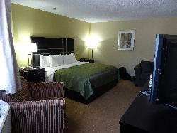 Room 125 at the Quality Inn in Bracebridge. A view of the front of the room.  Shows king size bed and sitting area.