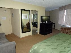 Room 125 at the Quality Inn in Bracebridge. A view of the front of the room.  Shows entrance, bathroom, and nook area.