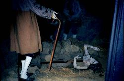 Inside the Salem Witch Dungeon Museum in 1994.  Display of a suspected witch with heavy rocks placed on her.