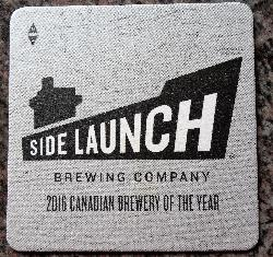 A beer coaster from Side Launch Brewing Company.  This 2017 version identifies Side Launch as the 2016 Canadian Brewery of the year.