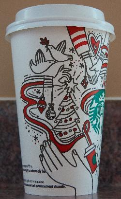 The left side of the starbucks medium coffee cup celebrating Christmas in 2017. Purchased in Ontario.  Contains various artistic drawings of Christmas related activites.