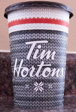 The front of the Tim Hortons large Christmas 2017 coffee cup. This is the Canadian version, found in Ontario.