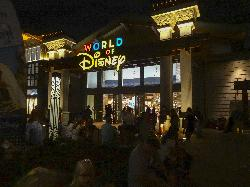 This is an evening photo of the World of Disney store, in Disney Springs Florida.  Disney Springs is a part of the Disney World Resort in Florida.