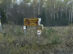 The Algonquin Park Boundary Sign located off of Hay Creek Road, near Whitney Ontario.