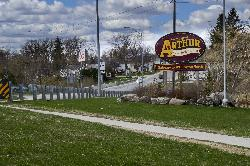 The official welcome sign to the town of Arthur Ontario.  Located at Highway 7 and Wellington County Road 109.  The sign says