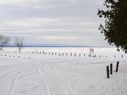 A winter landscape view of Wasaga Beach, the Blue Mountains and the Collingwood Terminals Limited Grain Elevator.  Photo was taken from the beach area 6 location of Wasaga Beach, across a frozen Georgian Bay.