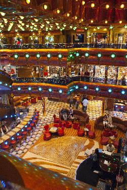 The multi level fun shops and piano Millenium Lobby on the Carnival Freedom Cruise Ship.