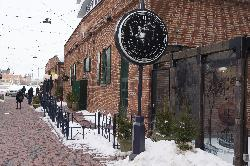 Photo of the front of building for the restaurant Cluny Bistro & Boulangerie.  Located in the distillery district in Toronto Ontario.