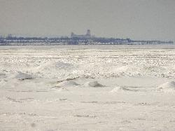 A winter 20x zoom view of the Collingwood Terminals Limited Grain Elevator, which is a landmark in Collingwood Ontario Canada.  Photo was taken from the beach area 6 location of Wasaga Beach, across a frozen Georgian Bay.