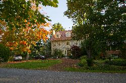 View of DownHome Bed and Breakfast house with fall colours.