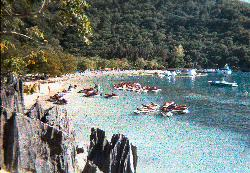 The jet skis and water playground at Labadee Beach while docked with the Explorer of the Seas from Royal Caribbean.  Scanned from negative from a water camera.