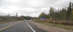 The Haliburton County boundary sign along highway 118 heading west.  Also shows the Highlands East Sign in the background.