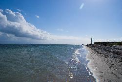 The scenic beach and lighthouse at Key Biscayne Florida.  On the shores of the Atlantic Ocean.