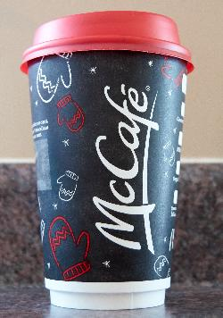 The front side of the McDonalds medium Christmas(Holiday) coffee cup in 2017. Purchased in Ontario.