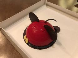 This is a photo of a chocolate chiffon cake at Amorette's in Disney Springs Florida.  The name is Mickey Mousse which pays tribute to Disney's Mickey Mouse.