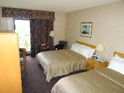 Room in Nottawasaga Inn Resort and Conference Centre, near Alliston Ontario.  View of two queen beds and patio doors.